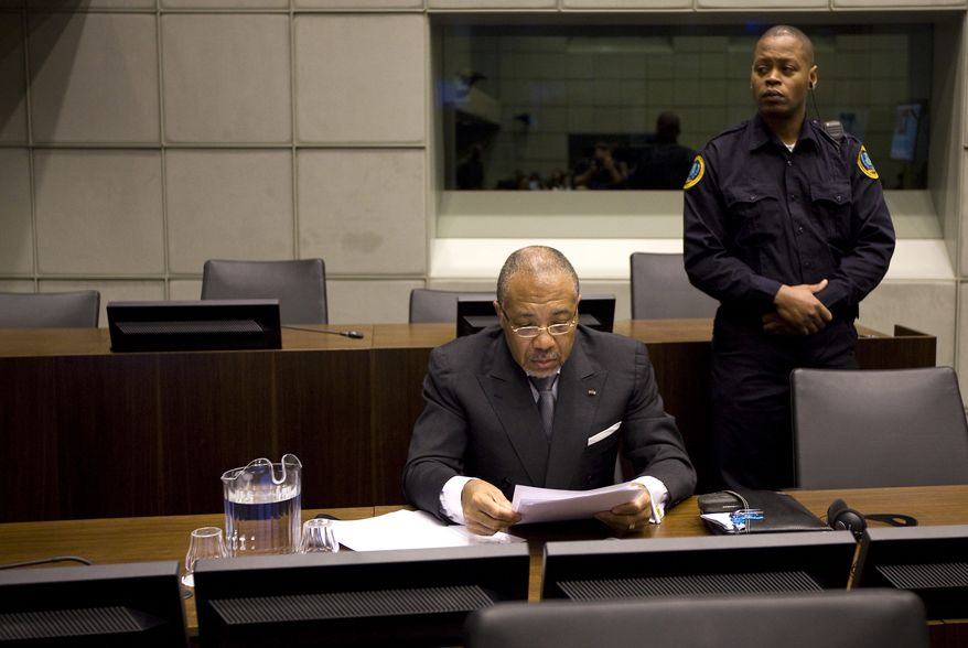 Former Liberian President Charles Taylor awaits the start of the prosecution's closing arguments during his war crimes trial at the U.N.-backed Special Court for Sierra Leone in Leidschendam, Netherlands, on Tuesday, Feb. 8, 2011. (AP Photo/Jerry Lampen, Pool)