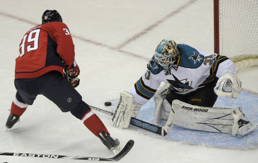 San Jose Sharks goalie Antti Niemi (31) stops a shot on goal by Washington Capitals left wing David Steckel (39) during the second period of their NHL hockey game at the Verizon Center in Washington, Tuesday, Feb. 8, 2011. (AP Photo/Susan Walsh)