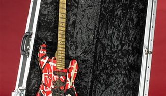 "This undated handout photo provided by the Smithsonian's National Museum of American History shows an Eddie Van Halen guitar. The museum announced that it has acquired the ""Frank 2"" guitar that Van Halen used during his 2007-2008 North American tour with original lead singer David Lee Roth. (AP Photo/Hugh Talman, Smithsonian's National Museum of American History)"
