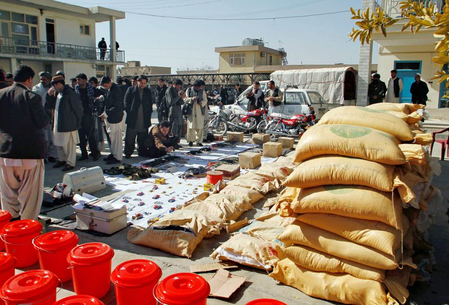Opium sacks, motor bikes and explosives confiscated by Afghan security forces in Kandahar are shown; allied forces are trying to make it harder for the Taliban to launch a spring offensive. (Associated Press)