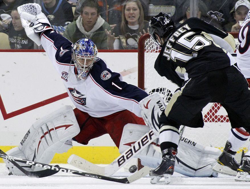 Pittsburgh Penguins Dustin Jeffrey (15) has a shot blocked by Columbus Blue Jackets goalie Steve Mason in the third period of an NHL hockey game in Pittsburgh, Tuesday, Feb. 8, 2011. The Blue Jackets won 4-1. (AP Photo/Gene J. Puskar)