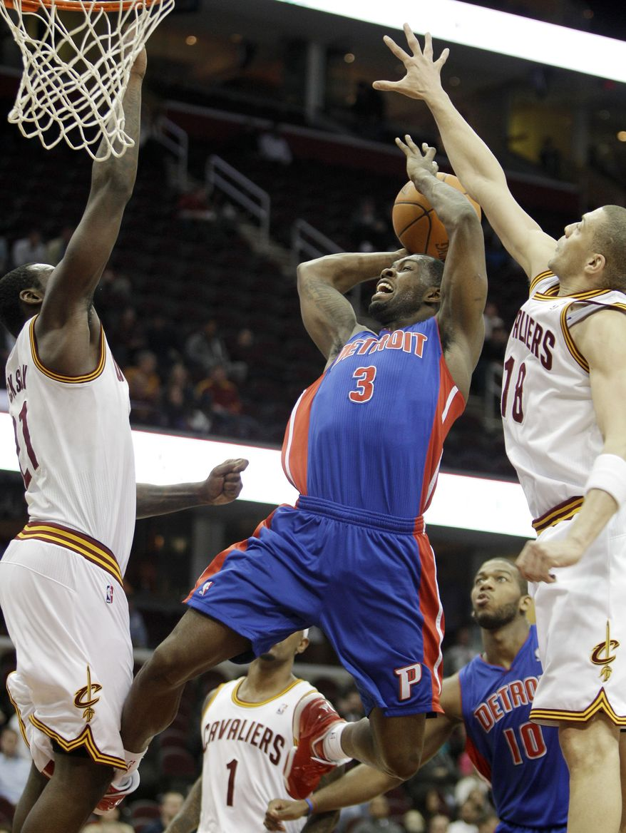 Detroit Pistons' Rodney Stuckey (3) shoots around Cleveland Cavaliers' J.J. Hickson (21) and Cleveland Cavaliers' Anthony Parker (18) in the fourth quarter in an NBA basketball game Wednesday, Feb. 9, 2011, in Cleveland. Cleveland's losing streak reached 26, matching the 1976-77 Tampa Bay Buccaneers' record for consecutive incompetence on Wednesday night with a 103-94 loss to the Detroit Pistons, who were supposedly a beatable opponent for the bottom-dwelling Cavs. (AP Photo)
