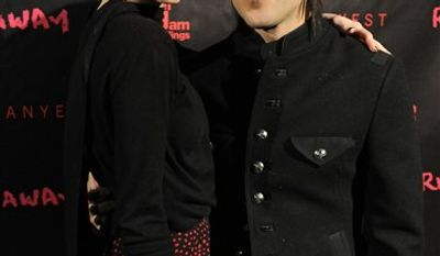 "FILE - In this Oct. 18, 2010 file photo, Pete Wentz and his wife Ashlee Simpson-Wentz arrive for a screening of ""Runaway,"" in Los Angeles. (AP Photo/Chris Pizzello, file)"