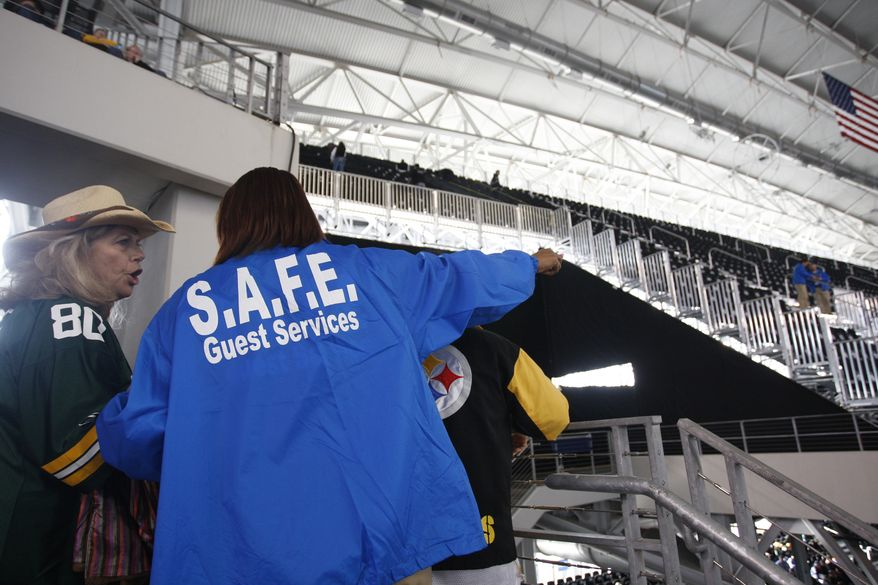 A ticket-holder, left, and guest services worker discuss the situation after some fans were denied access to the seats they bought for Super Bowl XLV at Cowboys Stadium Sunday, Feb. 6, 2011, in Arlington, Texas. (AP Photo/ Star-Telegram, Richard W. Rodriguez)