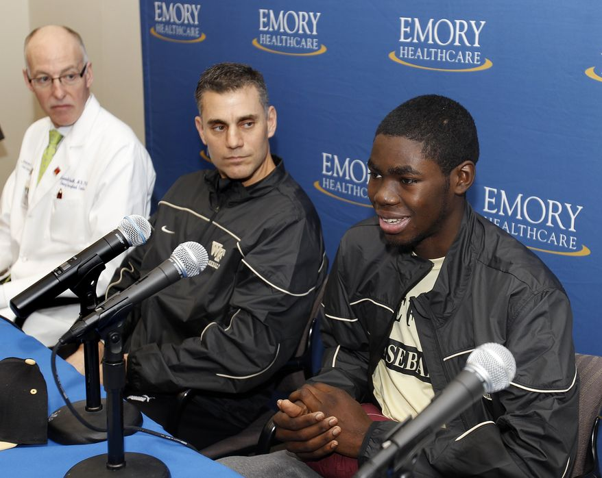 Wake Forest outfielder Kevin Jordan, right, speaks as his coach Tom Walter, center, and transplant surgeon Dr. Kenneth Newell look on during a news conference in at Emory University Hospital in Atlanta, Wednesday, Feb. 9, 2011, two days after Walter donated a kidney to Jordan. (AP Photo/John Bazemore)