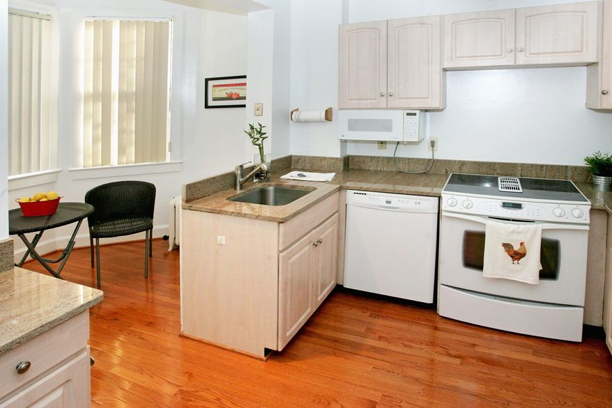 The renovated kitchen has granite counters, new appliances and is open to a breakfast room.