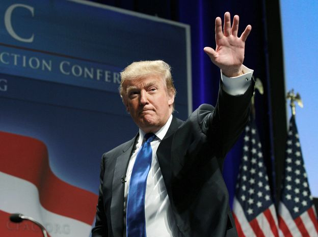 Donald Trump waves after addressing the Conservative Political Action Conference in Washington in February 2011. (AP Photo)
