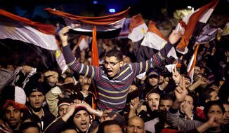 'GET OUT': Anti-government protesters scream with rage in Tahrir Square in downtown Cairo as Egyptian President Hosni Mubarak makes a televised speech to the nation on Thursday. The president did not step down as the protesters had hoped he would. (Associated Press)