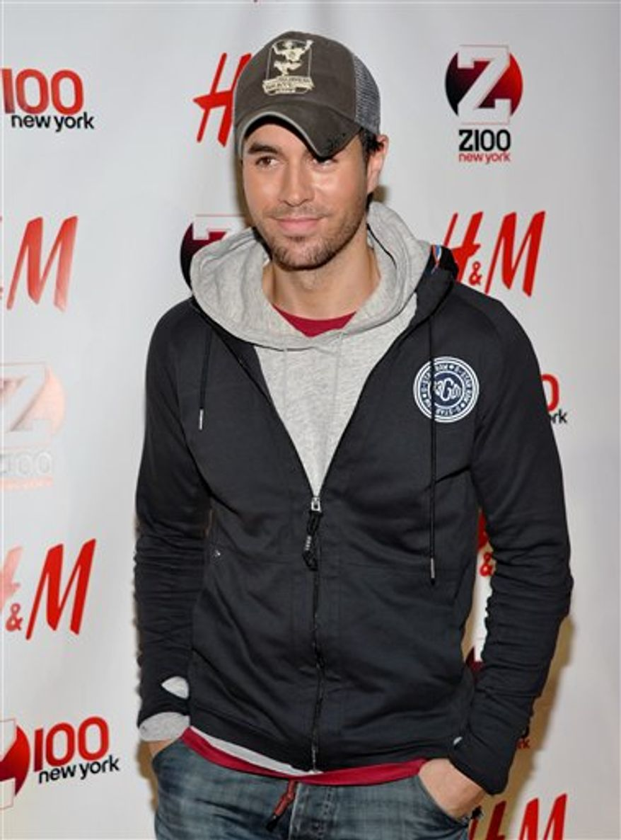 FILE - In this Dec. 10, 2010 file photo, singer Enrique Iglesias performs at the 2010 Z100 Jingle Ball concert at Madison Square Garden in New York. glesias dominates the list of finalists for the 22nd Billboard Latin Music awards with 14 nominations. Telemundo announced the nominees for the April 28, 2011, award ceremony to be aired live from the BankUnited Center at the University of Miami. (AP Photo/Peter Kramer, file)