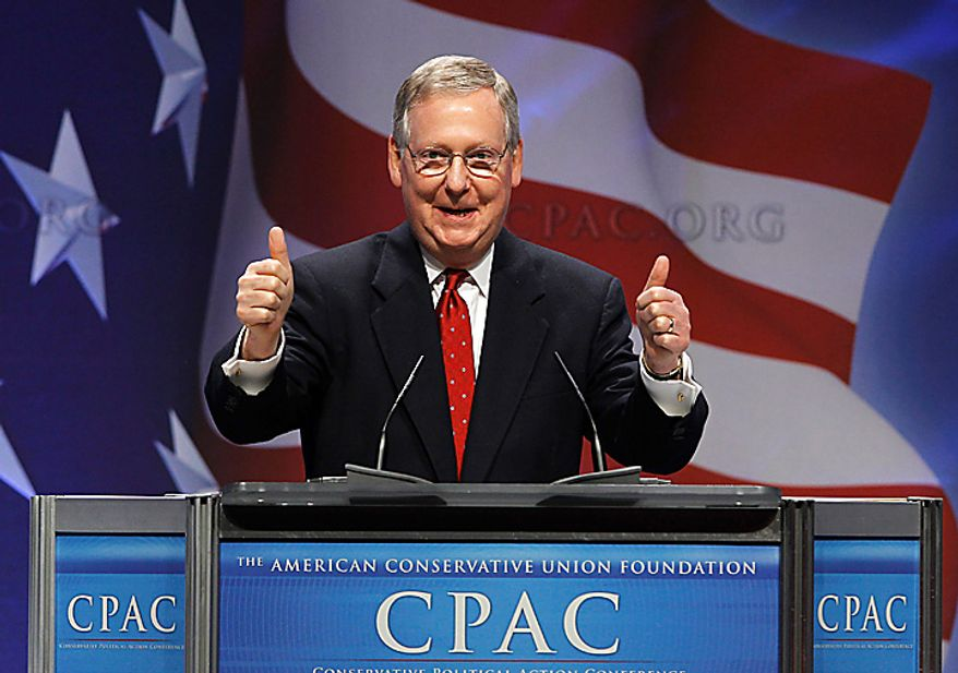 Senate Minority Leader Mitch McConnell, Kentucky Republican, gives two thumbs up while addressing the Conservative Political Action Conference (CPAC) in Washington on Thursday, Feb. 10, 2011. (AP Photo/Alex Brandon)