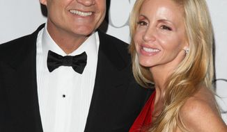** FILE ** In this June 13, 2010, file photo, Kelsey Grammer and his wife Camille Grammer arrive at the 61st Annual Tony Awards in New York. A judge has granted Kelsey Grammer a divorce from his wife, clearing the way for the actor to remarry later this month. (AP Photo/Peter Kramer, file)