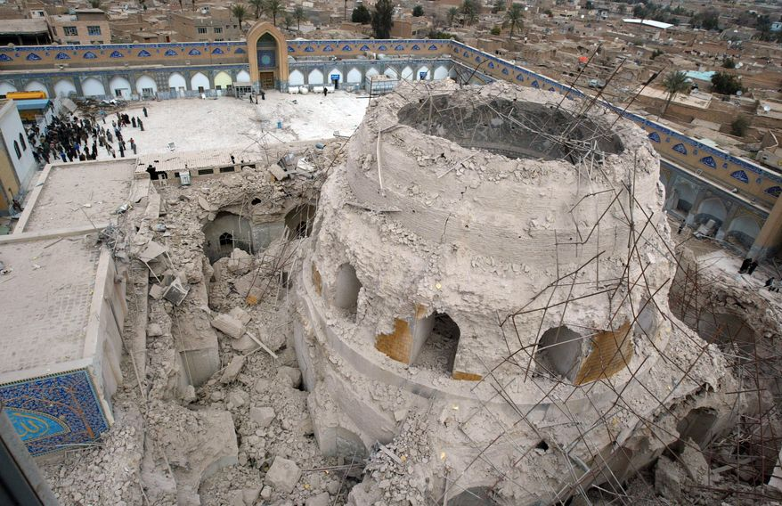 ** FILE ** Iraqis gather at the ruins of the al-Askari mosque in Samarra, Iraq, in February 2006. A car bomb killed eight pilgrims on Thursday, Feb. 10, 2011, as they made their way to the reconstructed mosque, one of Iraq's holiest Shi'ite shrines. (AP Photo/Khalid Mohammed, File)
