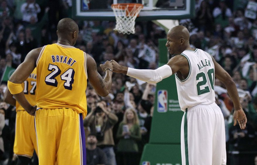 Boston Celtics guard Ray Allen, right, is congratulated by Los Angeles Lakers guard Kobe Bryant (24) after Allen set the NBA record for career 3-point baskets, during the first quarter of a basketball game in Boston, Thursday, Feb. 10, 2011. (AP Photo/Charles Krupa)