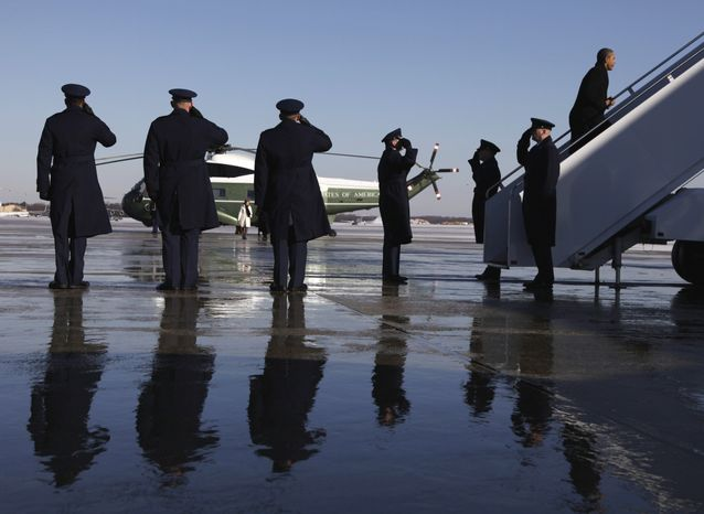 Military personnel salute President Obama as he boards Air Force One at Andrews Air Force Base outside Washington on Thursday, Feb. 10, 2011, en route to Marquette, Mich., where he is promoting high-speed wireless Internet access for almost all Americans. (AP Photo/Carolyn Kaster)
