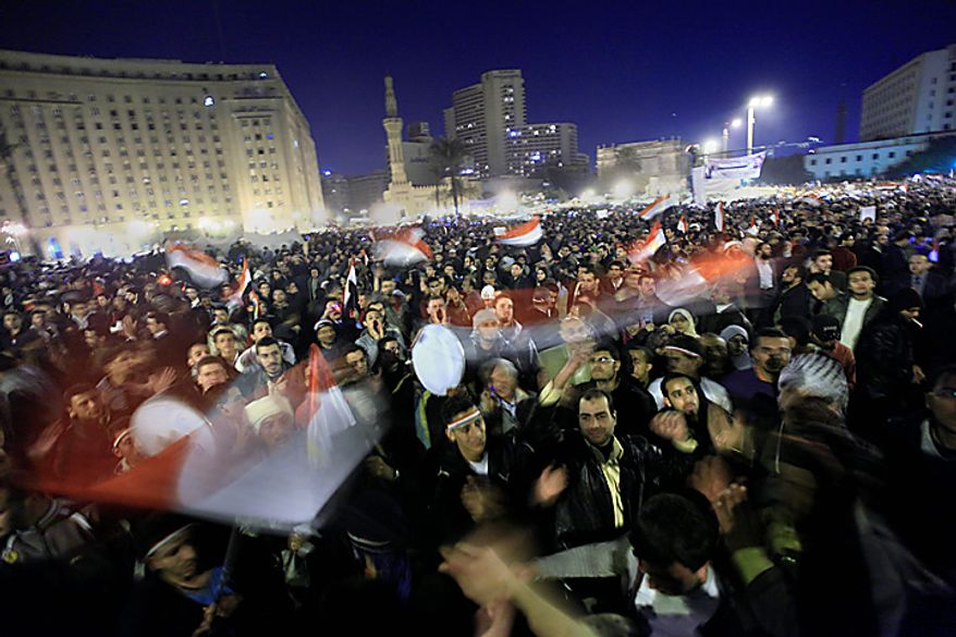 Anti-government protesters celebrate in Tahrir Square in downtown Cairo, Egypt, Thursday, Feb. 10, 2011. Egypt's military announced on national television it had stepped in to secure the country and promised protesters calling for President Hosni Mubarak's ouster that all their demands would soon be met. Tens of thousands of protesters packed in central Tahrir broke into chants of 'We're almost there, we're almost there' and waved V-for-victory signs as thousands more flowed in to join them well after nightfall. (AP Photo/Amr Nabil)