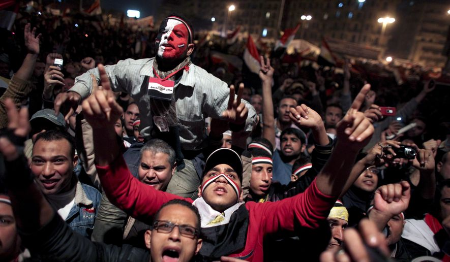 Egyptians celebrate the news of the resignation of President Hosni Mubarak, who handed control of the country to the military, at night in Tahrir Square in downtown Cairo, Egypt, on Friday, Feb. 11, 2011. (AP Photo/Tara Todras-Whitehill)