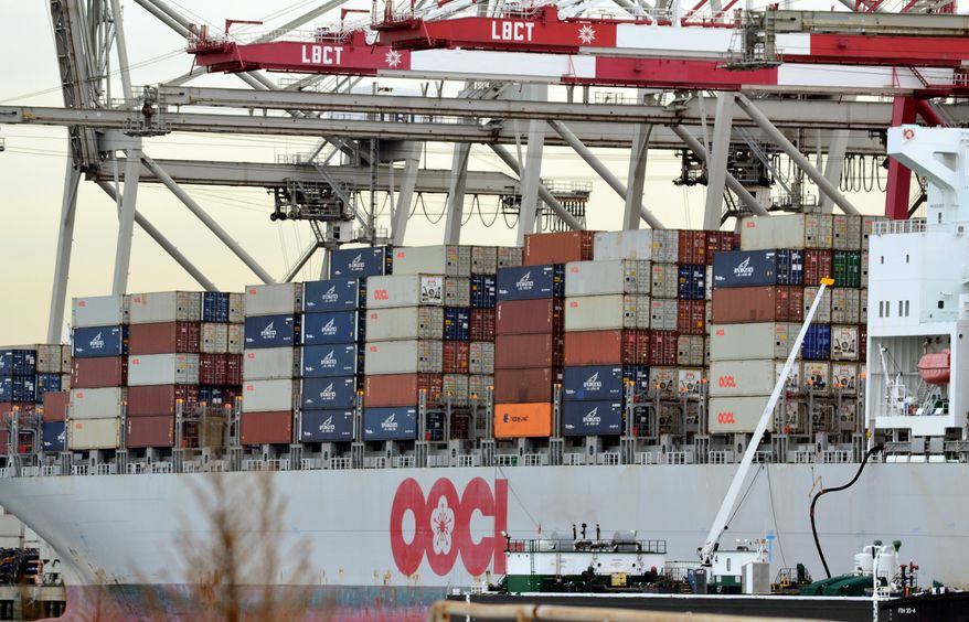 Shipping containers are loaded on a ship for export at the Port of Long Beach in Long Beach, Calif, on Jan. 10, 2011. The U.S. trade deficit widened in December, closing out a year in which America's trade gap ballooned by the largest amount in a decade.(AP Photo/Noaki Schwartz)