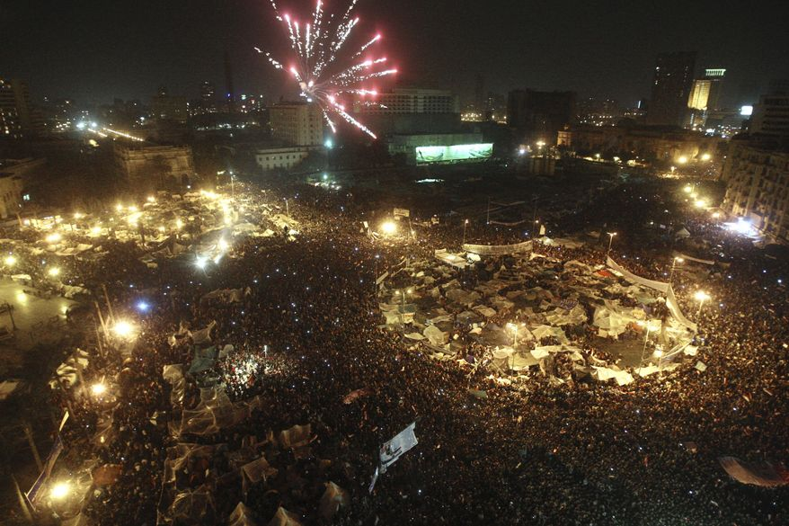 Fireworks are seen over Tahrir Square as Egyptians celebrate after President Hosni Mubarak resigned and handed power to the military in Cairo, Egypt, Friday, Feb. 11, 2011. (AP Photo/Ahmed Ali)