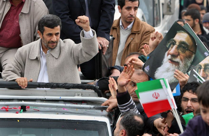 """Iranian President Mahmoud Ahmadinejad attends a rally marking the 32nd anniversary of 1979 Islamic Revolution in Azadi (Freedom) Street in Tehran Friday. Feb. 11, 2011. The president said Egypt's popular uprising shows a new Islamic Middle East is emerging, with no signs of Israel and U.S. """"interference."""" (AP Photo/Vahid Salemi)"""