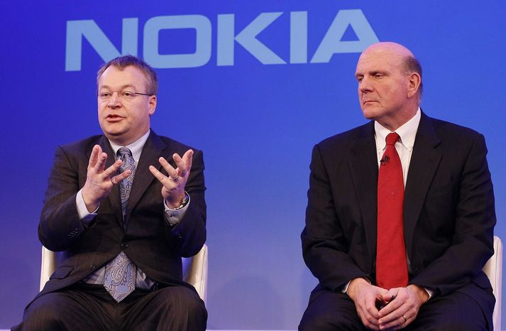 Stephen Elop CEO of Nokia, left, with CEO of Microsoft Steve Ballmer, speaking in London, as he announces the strategic partnership with Microsoft on Friday, Feb. 11, 2011. (AP Photo/Alastair Grant)
