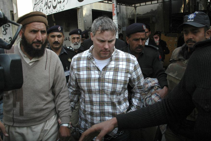 ** FILE ** Pakistani security officials escort Raymond Allen Davis (center), a U.S. Consulate employee, to a local court in Lahore, Pakistan, on Friday, Jan. 28, 2011. (AP Photo/Hamza Ahmed, File)
