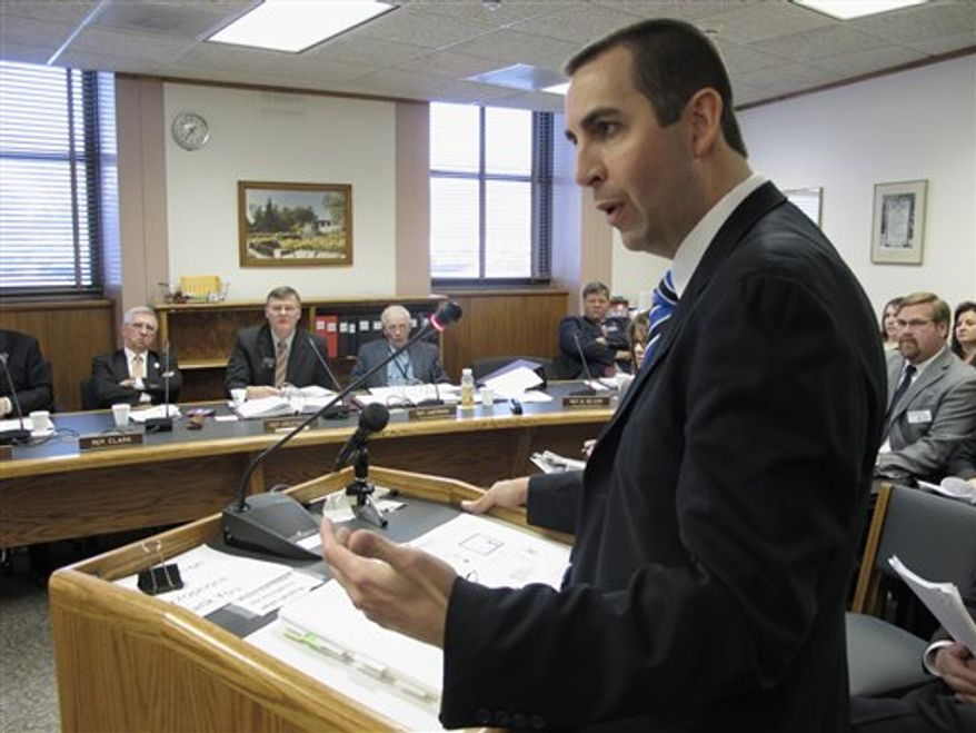 North Dakota Insurance Commissioner Adam Hamm speaks to the North Dakota House's Industry, Business and Labor Committee on Monday, Jan. 17, 2011, about legislation that helps to implement a federal health care reform law in North Dakota. The North Dakota Legislature will be reviewing a series of health-care measures during its 2011 session. (AP Photo/Dale Wetzel)