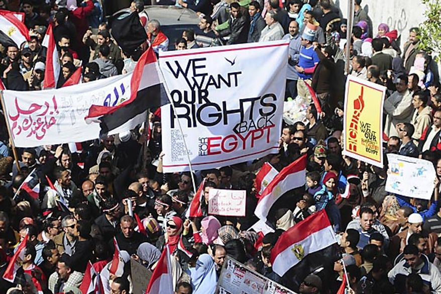 Thousands of Egyptian anti-government protesters march Alexandria, Egypt, Friday, Feb. 11, 2011. The government announced later Friday that President Hosni Mubarak has stepped down. (AP Photo/ Tarek Fawzy)