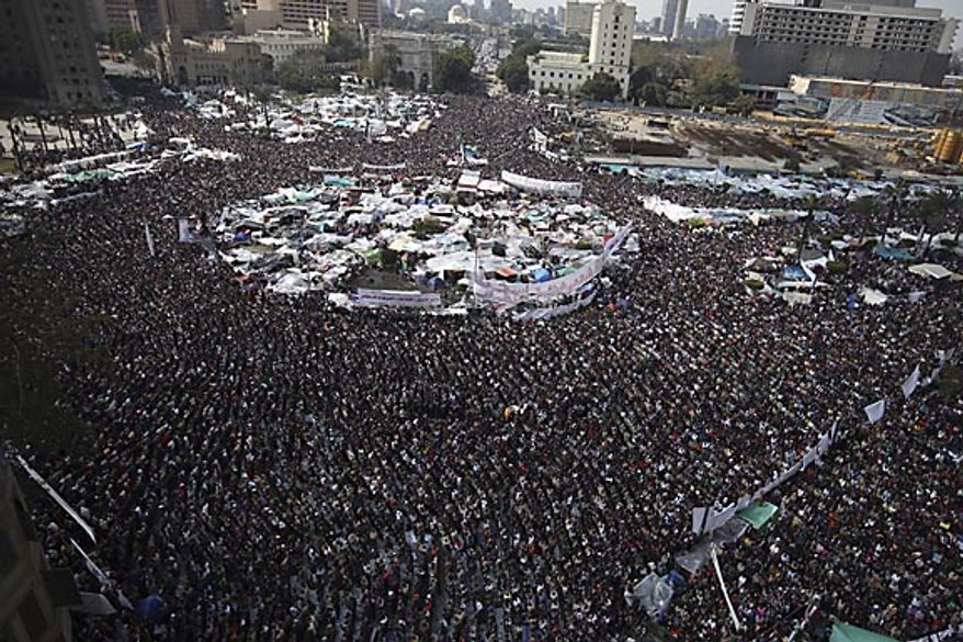 Anti-government protesters join in traditional Muslim Friday prayers in Tahrir Square in downtown Cairo, Egypt, Friday, Feb. 11, 2011. Hours later, the government announced that President Hosni Mubarak has stepped down. (AP Photo/Tara Todras-Whitehill)