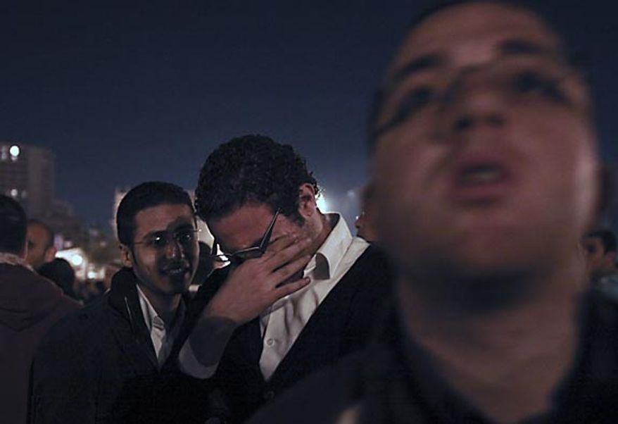 An anti-government protester in Cairo's Tahrir Square reacts in disappointment after Egyptian President Hosni Mubarak made a televised statement Thursday, Feb. 10, 2011, when he refused to resign. The Egyptian government announced Friday that Mr. Mubarak has stepped down. (AP Photo/Tara Todras-Whitehill)