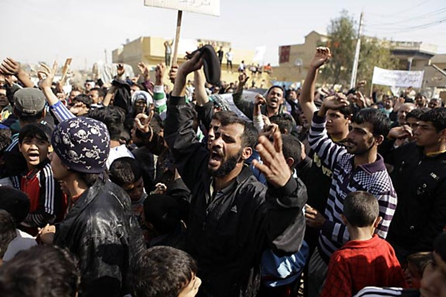 Protesters chant anti-government slogans during a demonstration in Baghdad, Iraq, Friday, Feb. 11, 2011. In at least four morning demonstrations across Baghdad, protesters painted a picture of their homeland that they said has fewer services and more corruption than in Egypt. (AP Photo/Karim Kadim)