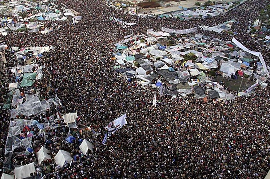 Tens of thousands of anti-government protesters gather in Tahrir Square in Cairo, Egypt, Friday, Feb. 11, 2011. President Hosni Mubarak stepped down Friday. (AP Photo/Amr Diab)