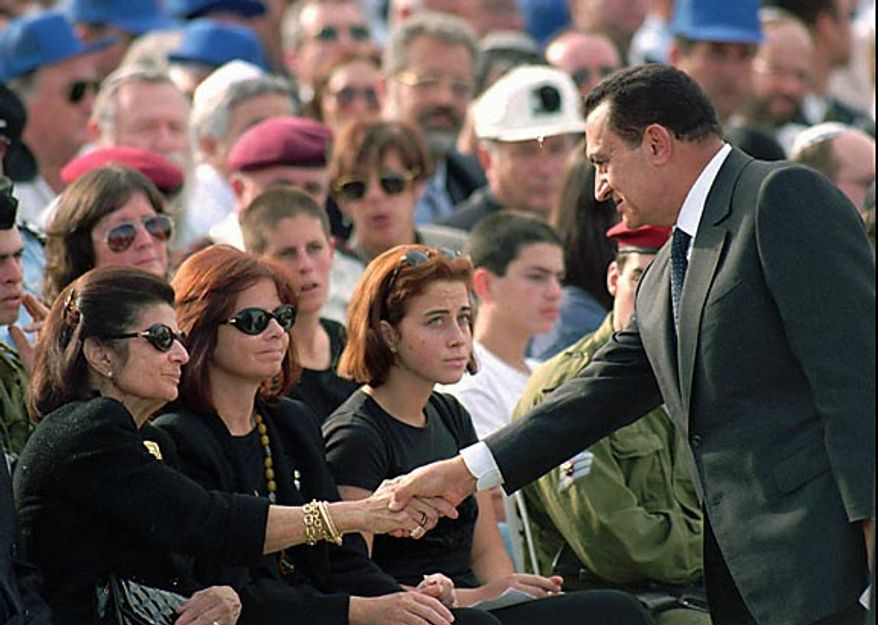 Egyptian President Hosni Mubarak, right, shakes hands with Leah Rabin, left, widow of assassinated Israeli Prime Minister Yitzhak Rabin, at Rabin's funeral in Jerusalem, on Nov. 6, 1995.  (AP Photo/Santiago Lyon, File)