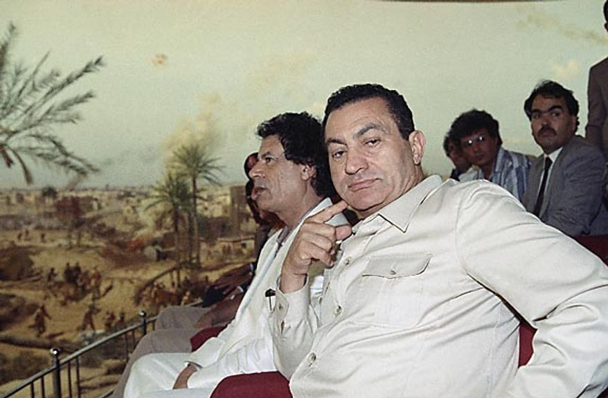 Libyan leader Moammar Gadhafi and Egyptian President Hosni Mubarak visit a panorama and weapons exhibition of the 1973 Arab-Israeli war in Cairo on June 1, 1990. (AP Photo/File)