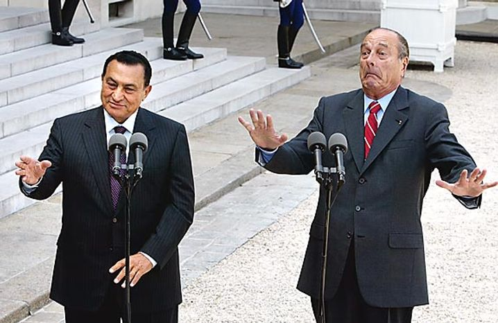 French President Jacques Chirac, right, and his Egyptian counterpart Hosni Mubarak gesture during a press conference at the Elysee Palace in Paris on July 25, 2002. (AP Photo/Michel Euler, File)