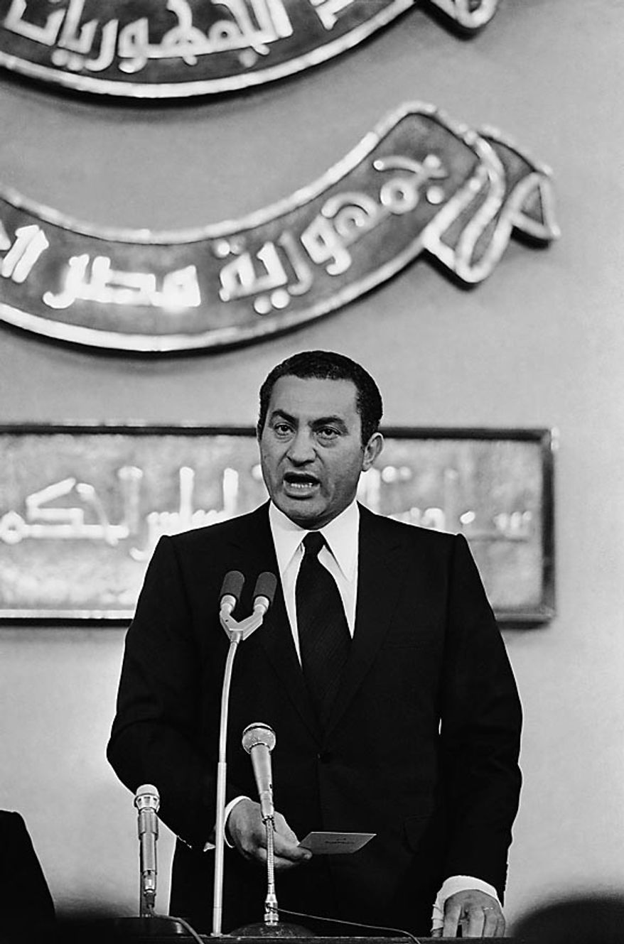 Hosni Mubarak speaks at his swearing-in ceremony as Egypt's fourth president in the People's Assembly building in Cairo on Oct. 14, 1981. (AP Photo/Bill Foley, File)