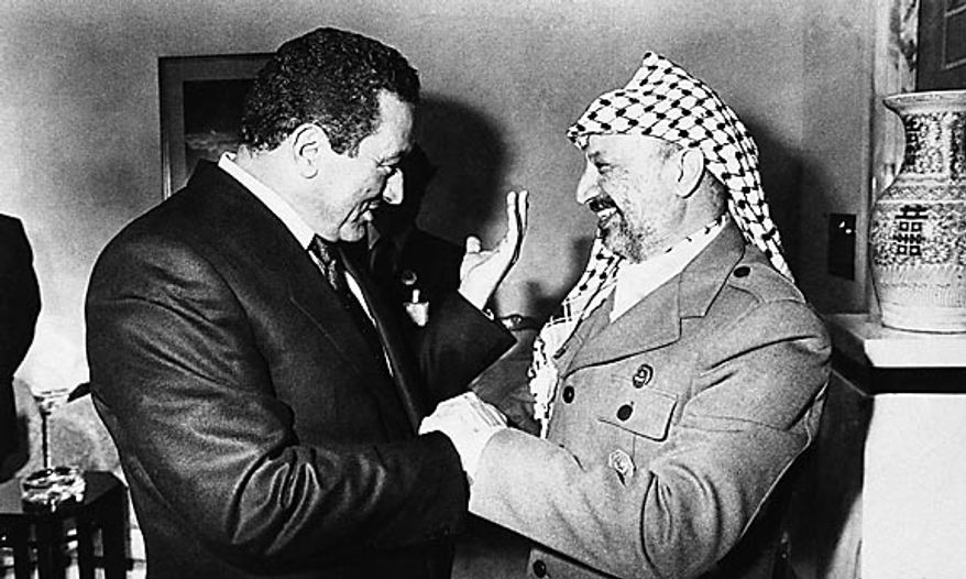 Egyptian President Hosni Mubarak, left, speaks with Palestine Liberation Organization leader Yasser Arafat in Kuwait at the sidelines of the 5th Islamic Summit on Jan. 27, 1987. (AP Photo/File)