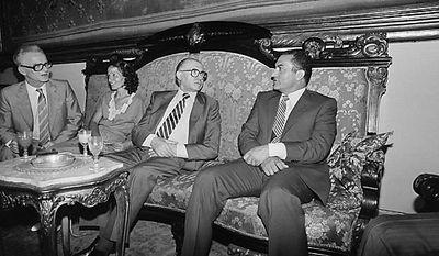Egyptian Vice-President Honsi Mubarak, right, speaks with Israeli Prime Minister Menachem Begin in Alexandria, Egypt, on Aug. 18, 1981. (AP Photo/File)