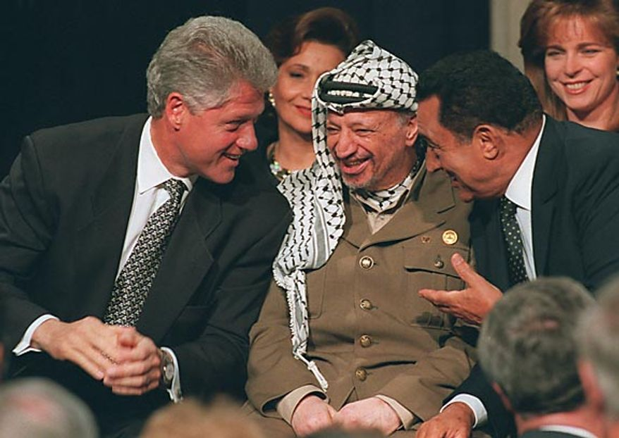 President Bill Clinton, left, speaks with Yassar Arafar, center, and Egyptian President Hosni Mubarak, right, during a reception for Middle East leaders in Washington on Sept. 28, 1995. (AP Photo/Doug Mills, File)