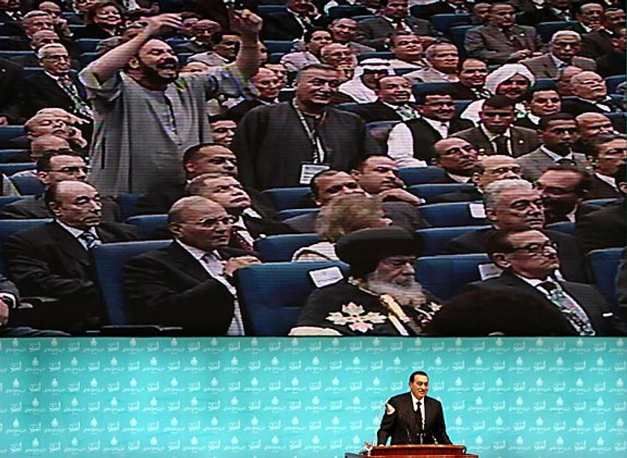 Egyptian President Hosni Mubarak listens to a member of the audience during a speech at the opening of Egypt's ruling National Democratic Party's 6th annual congress in Cairo on Oct. 31, 2009.  (AP Photo/Amr Nabil, File)