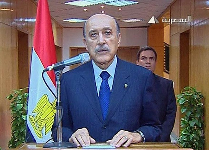 In this photo taken from Egyptian television, Egypt's Vice President Omar Suleiman makes the announcement that Egyptian President Hosni Mubarak has stepped down from office, Friday, Feb. 11, 2011, in Cairo. (AP Photo/Egypt TV)