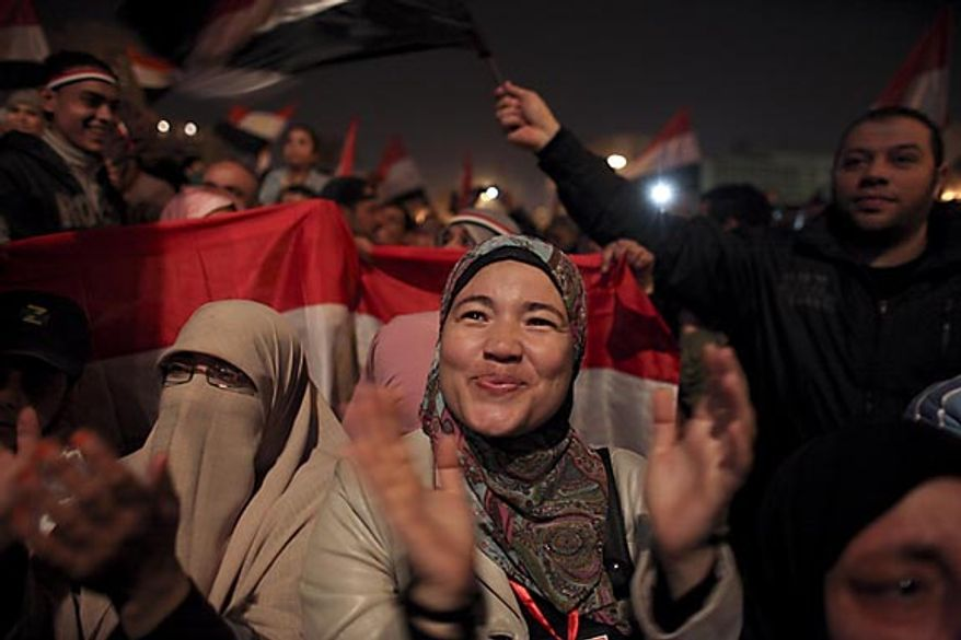 Egyptian women celebrate the news of the resignation of President Hosni Mubarak, who handed control of the country to the military, at night in Tahrir Square in Cairo, Egypt, Friday, Feb. 11, 2011. (AP Photo/Tara Todras-Whitehill)