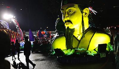 Performers walk among floats during the Chingay Parade, a multicultural street performance that was part of the Chinese new year celebrations in Singapore, on Friday Feb. 11, 2011. (AP Photo/Wong Maye-E)