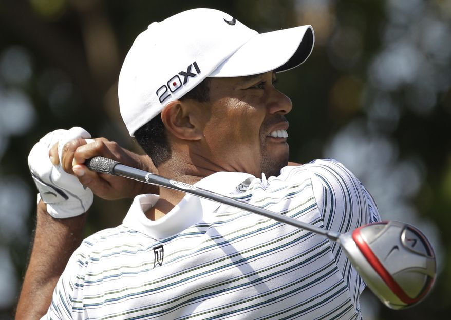 Tiger Woods tees off on the 2nd hole during the third round of the Dubai Desert Classic golf tournament at the Emirates Golf Club in Dubai, United Arab Emirates, Saturday, Feb. 12, 2011. (AP Photo/Kamran Jebreili)