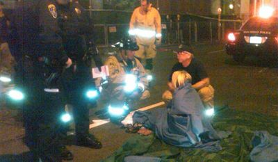 This image provided by the San Diego Fire and Rescue Department shows San Diego Fire Department paramedics assisting a victim at the site of a crash where a taxi cab driver plowed slowly into a crowd on a sidewalk in San Diego's busy Gaslamp District Saturday Feb. 12, 2011, injuring more than two dozen people, police said. (AP Photo/ San Diego Fire and Rescue Department, Maurice Luque)