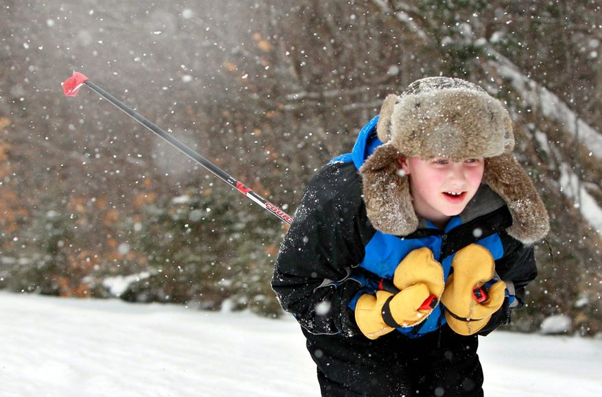Associated Press photographs Noah Hixon, a fourth-grader at the New Sweden Consolidated School in New Sweden, Maine, cross-country skis during a physical education class.