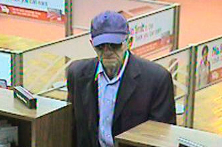 """Associated Press This image provided by the FBI shows the """"Geezer Bandit"""" robbing a bank in Goleta, Calif. The FBI has looked into whether the suspect might be wearing a mask that hides his real age."""