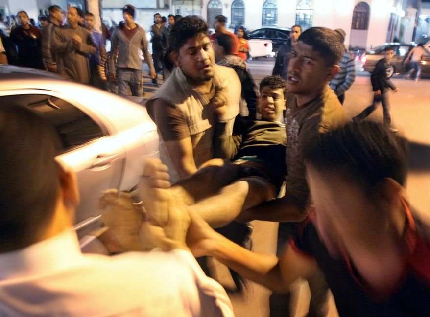 A Bahraini is wounded by birdshot after riot police open fire on a demonstration in Karzakan, Bahrain.