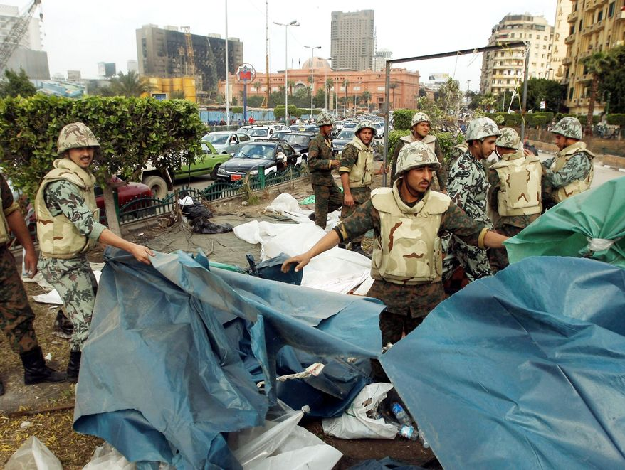 Associated Press photographs DECAMPING: Egyptian soldiers Sunday take down tents used by demonstrators in Tahrir Square in Cairo. It was part of an effort to restore normalcy to the Egyptian capital after more than two weeks of demonstrations that culminated in the resignation of Egyptian President Hosni Mubarak.