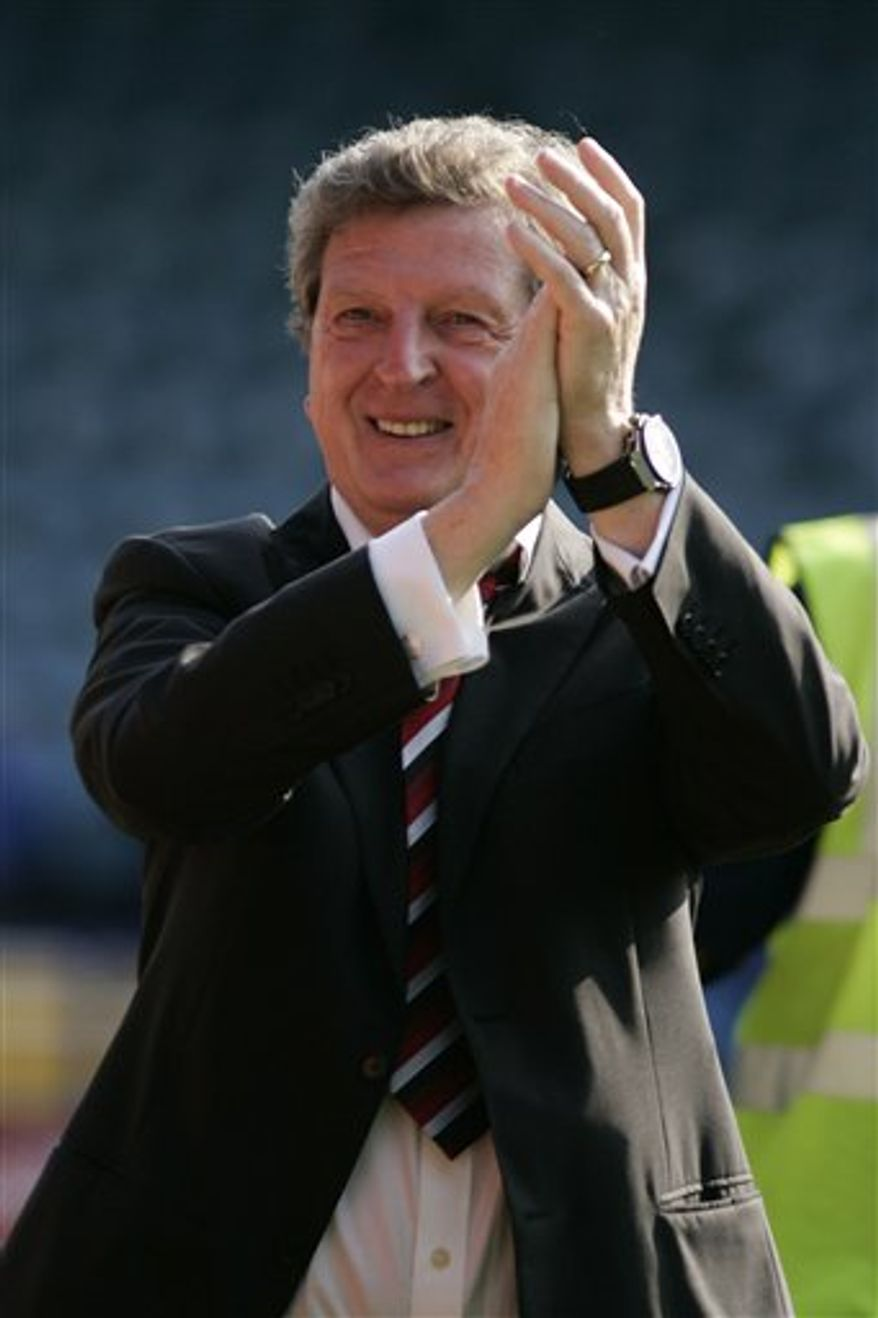 FILE - In this Sunday, May 11, 2008 file photo, Fulham's manager Roy Hodgson applauds the supporters as he celebrates his team win against Portsmouth to retain their place in Premier League at the end of their English Premier League soccer match at Fratton Park, Portsmouth, England. West Bromwich Albion has hired Roy Hodgson as coach in the hope that England's manager of the year can save it from relegation from the Premier League. The 63-year-old Hodgson has signed a contract tying him to the Premier League's 17th-place club until the end of next season. Hodgson was fired by Liverpool last month despite his status as last season's manager of the year.  (AP Photo/Sang Tan, File)  NO INTERNET/MOBILE USAGE WITHOUT FAPL LICENCE - SEE IPTC SPECIAL INSTRUCTIONS FIELD FOR DETAILS