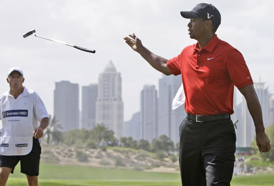 Tiger Woods from U.S. tees off on the 2nd hole during the final round of Dubai Desert Classic golf tournament at the Emirates Golf Club in Dubai, United Arab Emirates, Sunday Feb. 13, 2011. (AP Photo/Kamran Jebreili)